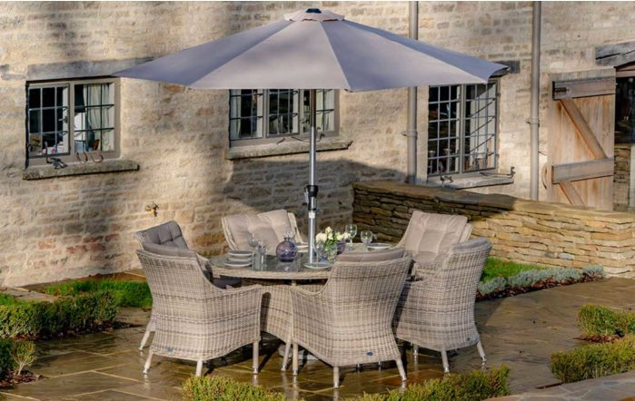 Bramblecrest Ascot 175 x 120cm Elliptical Table with 6 Armchairs & Parasol